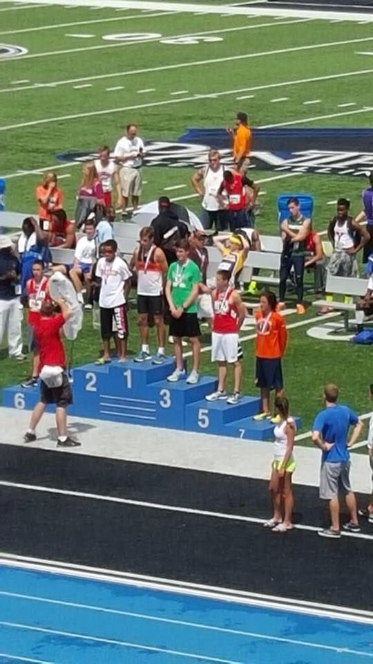 Jack on the medal stand in the green shirt.